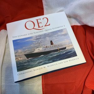 QE2 Commemorative book signed by Commodore Warwick