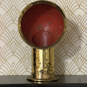Vintage brass ships ventilation duct, with red painted interior.